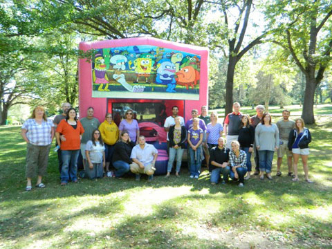 Employees of Terracon's Bettendorf office and their families gather for their annual company picnic.