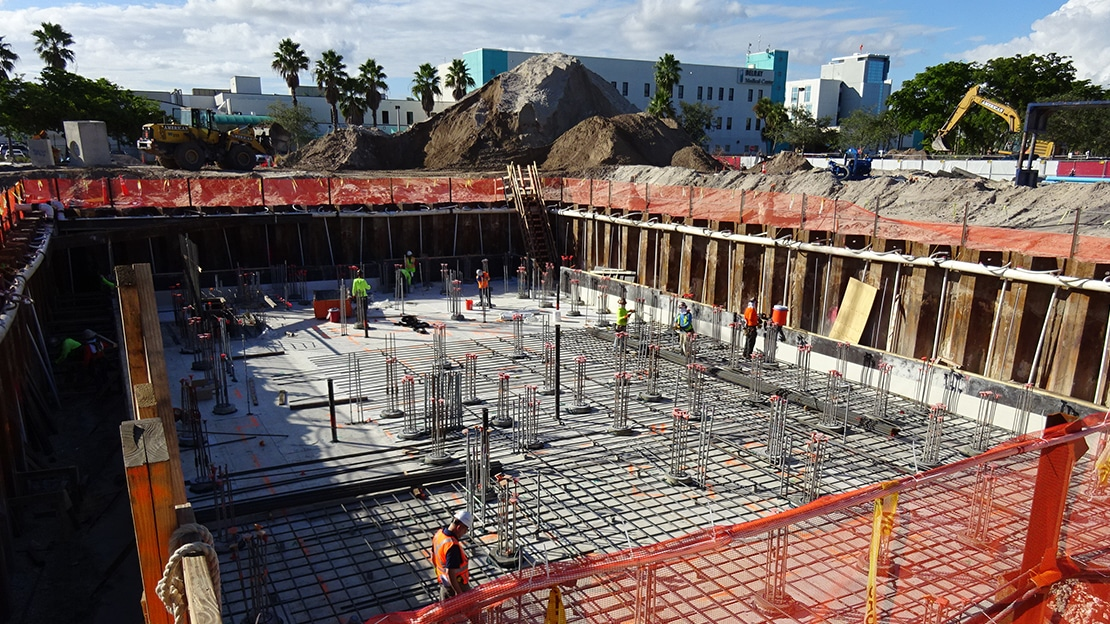 Proton theraphy equipment is shown during waterproofing before concrete placement begins