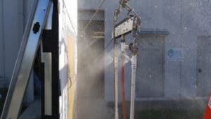 High pressure spray during ASTM E1105 water testing.